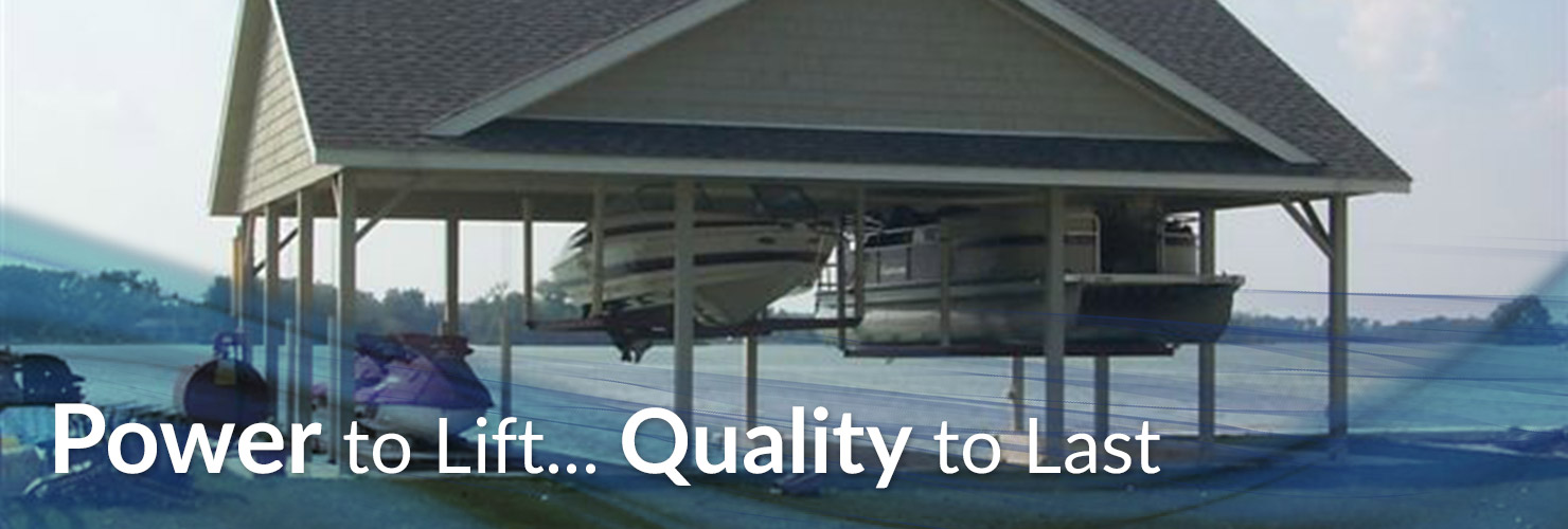 Boats lifted with Davit Master Boathouse Lifts under a boathouse
